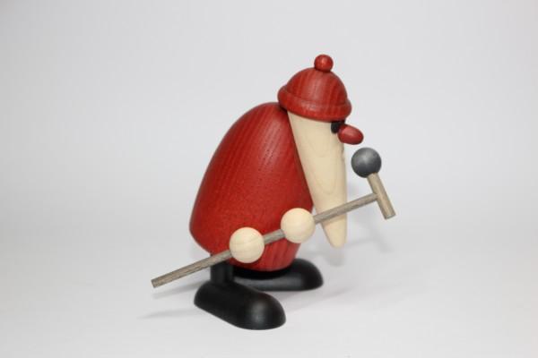 Weihnachtsmann am Mikrofon extrovertiert